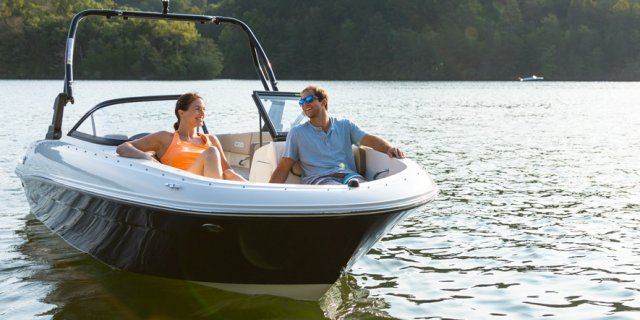 A couple in their Bayliner BR4 on the water in Muskoka near Toronto Ontario