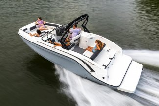 a happy family relax aboard a bayliner DX 2250 boat as they commute across a lake.