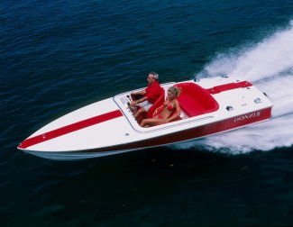 a donzi speed boat with a couple from muskoka relaxing aboard.