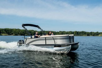 A Harris 210 Cruiser pontoon Boat with a happy Toronto couple enjoying a vacation on Gordon Bay water.