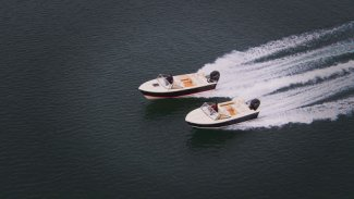two rossiter boats speeding along Gordon Bay water